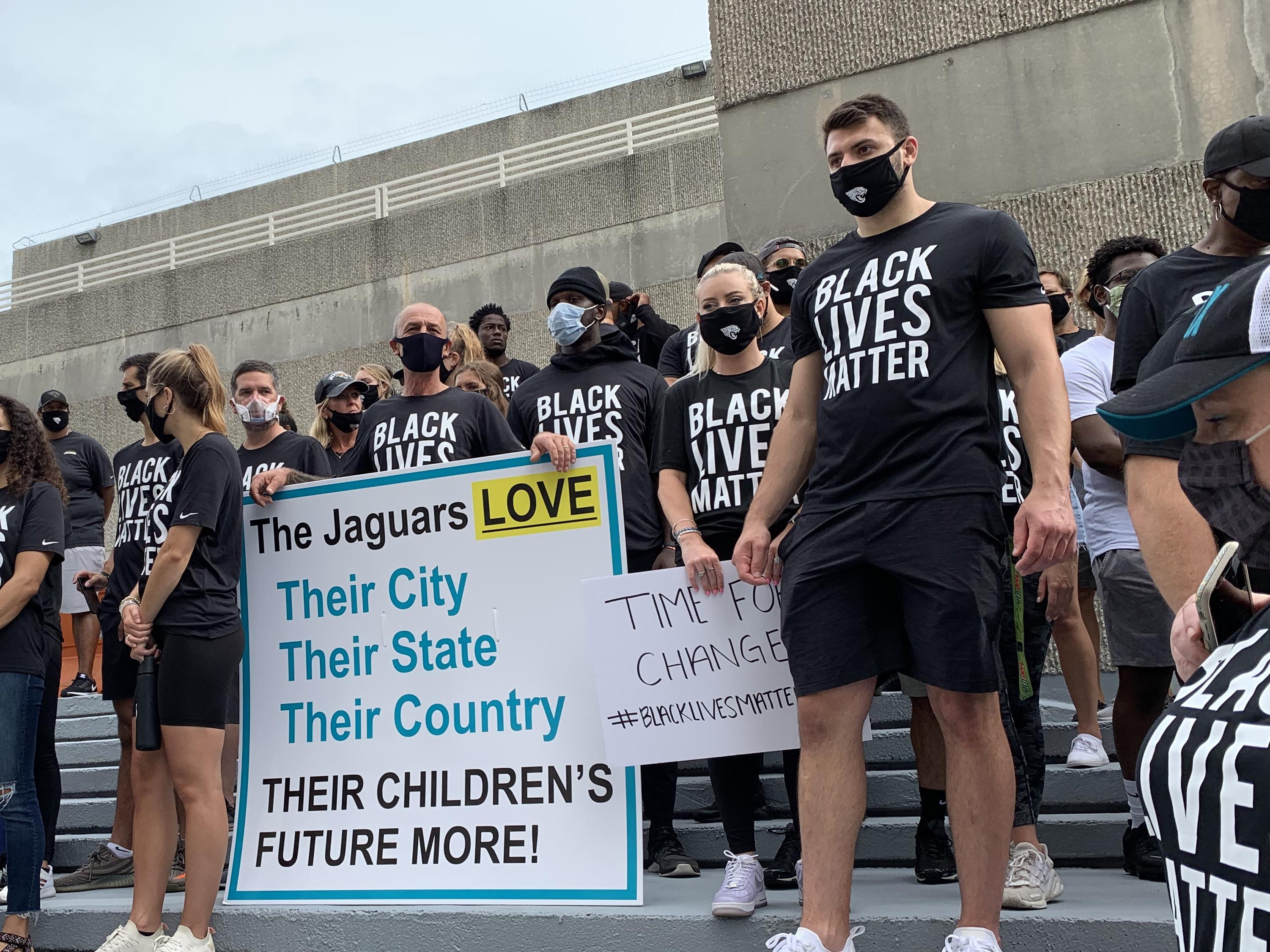 Members of the Jaguars organization, including rookie tight end Tyler Davis (right) stand on the steps of the Jacksonville Sheriff's Office during a peaceful protest on Friday. (TRIBUNE NEWS SERVICE)