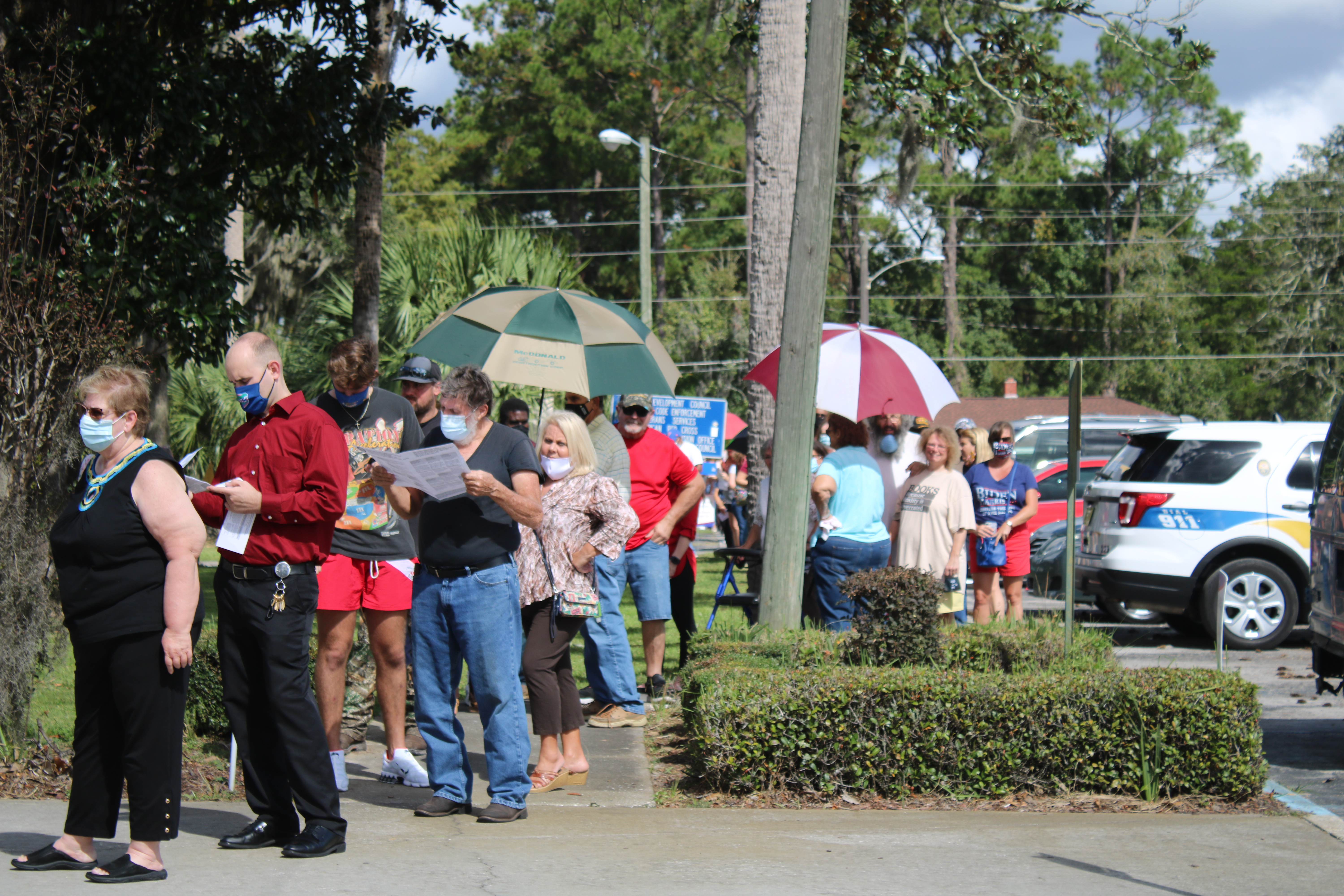 Voters wait in line outside the Columbia County Supervisor of Elections Office Thursday during the first day of early voting. More than 1,700 local voters cast ballots during the first day of early voting. (TONY BRITT/Lake City Reporter)