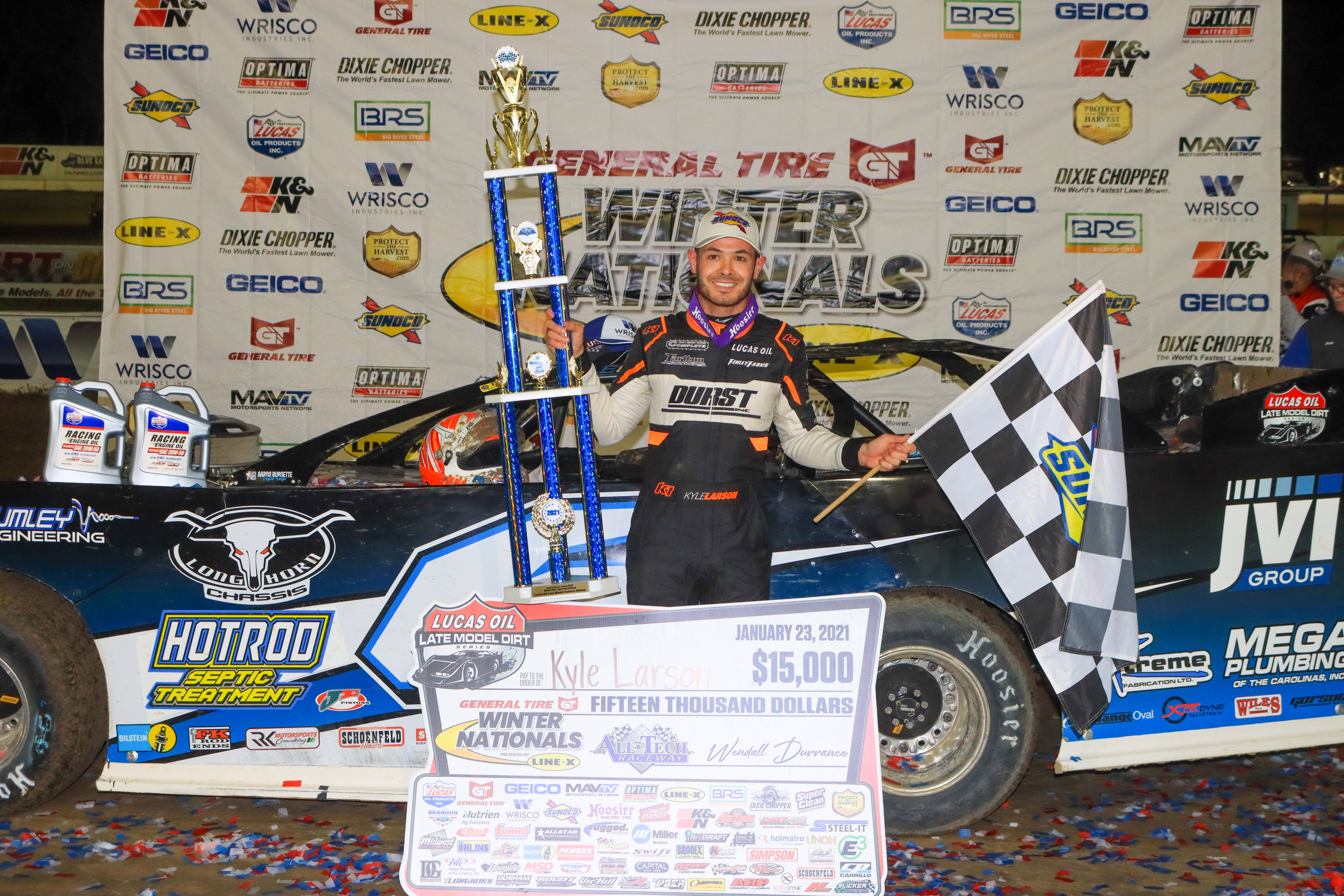 Kyle Larson poses with the first-place trophy after winning the General Tire Winter Nationals at All-Tech Raceway on Saturday night. Larson received a prize of $15,000. (LOVIN' DIRTY PHOTOGRAPHY )