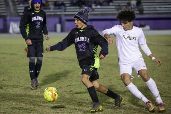 Columbia's Jason Caballero dribbles around Forest player on Tuesday night. The Tigers and Wildcats will face each other in the District 2-6A quarterfinals on Feb. 3. (BRENT KUYKENDALL/Lake City Reporter)
