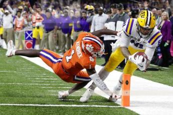 LSU tight end Thaddeus Moss scores a touchdown past Clemson cornerback Derion Kendrick during the second half of the College Football Playoff national championship game Monday, in New Orleans. (SUE OGROCKI/Associated Press)
