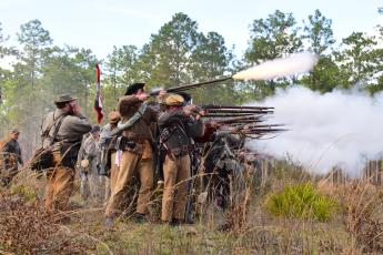 Confederate soldiers fire at Union troops during the 2018 Battle of Olustee Re-enactment on the site of the original 1864 battle. The re-enactment and Olustee Battle Festival, which is held in Lake City, are set for mid-February. (FILE)