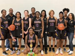 Columbia's girls basketball team with the third-place trophy at the B-Town Classic in South Carolina. (COURTESY)