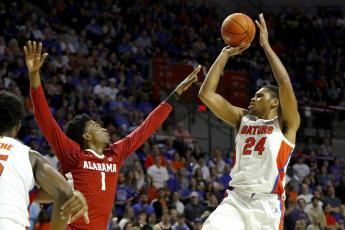 Florida forward Kerry Blackshear Jr. takes a jump shot over Alabama's Herbert Jones (1) during Saturday's game at the O'Connell Center. (TRIBUNE NEWS SERVICE)