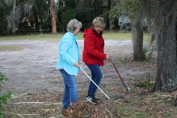 "Garden Club members Carol Stevens and Tina Roberts pick up litter near McCray Avenue on Saturday during Lake City's inaugural ""Take Pride in Your Community Clean-Up Campaign."" (MICHAEL PHILIPS/Lake City Reporter)"