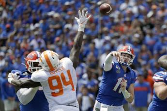 Florida quarterback Kyle Trask threw for 293 yards in his first career start Saturday. (ASSOCIATED PRESS/JOHN RAOUX)