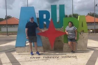 Lake City residents Ovidiu and Sondra Deaconescu pose for a picture in Aruba while on a cruise. Their trip was unexpectedly extended yesterday, when Puerto Rican officials refused to let passengers from the ship disembark. (COURTESY)
