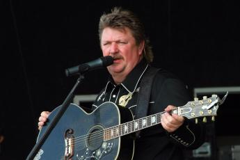 Country star Joe Diffie is seen on stage in this file photo from 2009 Jamboree In The Hills in Morristown, Ohio. (AP FILE PHOTO)