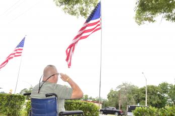 Larry Carter, a retired Army airborne infantryman, salutes the flag on Memorial Day outside the Lake City VA hospital. (CARL MCKINNEY/Lake City Reporter)