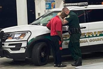 Deputy Chris Alford comforts a young man after an encounter with racists at a local store. (COURTESY CCSO)