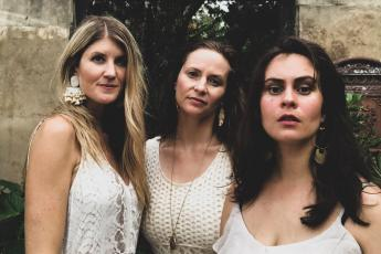 "Americana band The Krickets poses for a photograph to promote their music. Pictured in the middle is Lake City's own singer-songwriter Rachel Grubb, who is featured in the group's new single, ""These Games,"" which releases Friday. Also pictured are Lauren Spring, left, and Emily Stuckey. (COURTESY)"