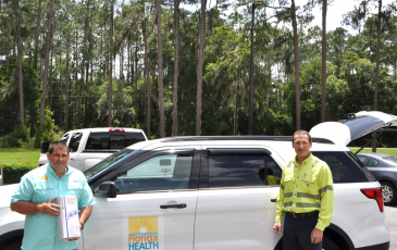 Tom Moffses, administrator, Columbia/Hamilton Health Department, left, is seen with William Ponton, general manager, Nutrien-White Springs. In the car are a total of 10,200 masks, a gift from Nutrien to the local DOH. (COURTESY)