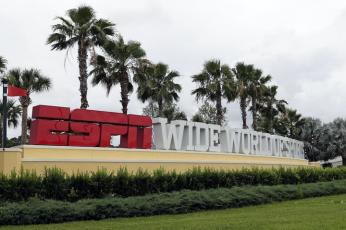 A sign marking the entrance to ESPN's Wide World of Sports at Walt Disney World is seen Wednesday, in Kissimmee. (JOHN RAOUX/AP Photo)