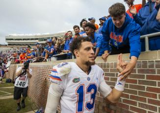 Florida quarterback Feleipe Franks (13) gets congratulated by fans after defeating Florida State 41-14 on Nov. 24, 2018, in Tallahassee. (AP FILE PHOTO)