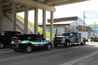 The Florida Department of Law Enforcement's crime scene technicians helped process the scene on Northwest Railroad Street where a black female body was found Friday morning. (TONY BRITT/Lake City Reporter)