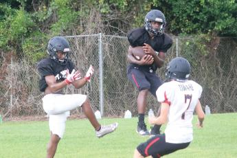Fort White defensive back Gene Smith intercepts a pass during Wednesday's practice. (JORDAN KROEGER/Lake City Reporter)