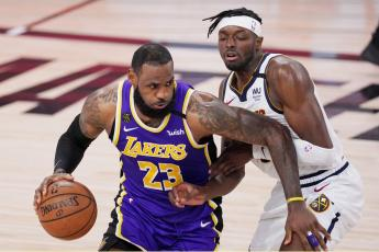 Los Angeles Lakers' LeBron James (23) drives against Denver Nuggets' Jerami Grant during Game 5 of the Western Conference finals on Saturday, in Lake Buena Vista. (MARK J. TERRILL/Associated Press)