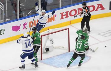 Tampa Bay Lightning center Steven Stamkos, top left, celebrates his goal against Dallas Stars goaltender Anton Khudobin (35) during the first period of Game 3 of the Stanley Cup Final on Wednesday, in Edmonton, Alberta. (JASON FRANSON/The Canadian Press via AP)
