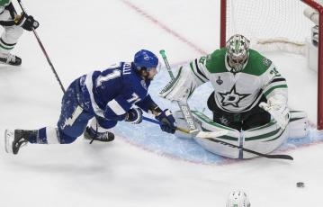 Tampa Bay Lightning center Anthony Cirelli (71) can't get to the puck as Dallas Stars goaltender Anton Khudobin (35) covers the net during the first overtime in Game 5 of the NHL hockey Stanley Cup Final on Saturday, in Edmonton, Alberta. (JASON FRANSON/The Canadian Press via AP)