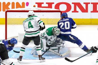 Dallas Stars goaltender Anton Khudobin (35) makes a save against the Tampa Bay Lightning's Blake Coleman (20) during the third period in Game 1 of the Stanley Cup Final at Rogers Place on Saturday, in Edmonton, Canada. The Stars won, 4-1. (BRUCE BENNETT/Getty Images/TNS)