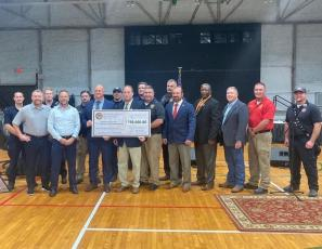 Suwannee County officials with state legislators Chuck Brannan and Rob Bradley after receiving a check for $750,000 in state appropriations for a new fire station. (COURTESY Suwannee County Fire Rescue)