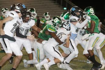 Suwannee defensive lineman Garris Reed, left, and linebacker Blaine Howard wrap up Ponte Vedra running back Campbell Parker on Friday night. (PAUL BUCHANAN/Special to the Reporter)