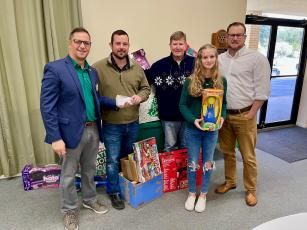 Rotary President Lee Pinchouck, Rotarian Chase Moses, Elks Toy Drive Chairman and Rotarian George Brannon, Abby Candler and Rotarian Chris Candler with monetary and toy donations given to the Elks Toy Drive. (COURTESY)
