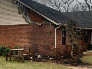 A home off 152nd Street in western Suwannee County sustained minor damage Wednesday after a heat lamp sparked a fire outside the house. (COURTESY SUWANNEE FIRE RESCUE)