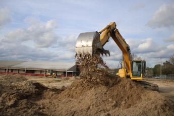 Ken Wells, of Bubba's Site Prep, uses an excavator to move dirt while prepping a site for the Westside Elementary School multi-purpose room. Construction on the project began last week and is expected to be completed by the end of summer. (TONY BRITT/Lake City Reporter)