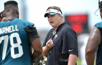 Ex-Jacksonville Jaguars coach will join Nick Saban's staff at Alabama to coach the offensive line. (TRIBUNE NEWS SERVICE)
