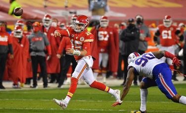 Kansas City Chiefs quarterback Patrick Mahomes throws a pass in the first half of the AFC championship game while being pressured by Buffalo Bills defensive tackle Quinton Jefferson on Sunday at Arrowhead Stadium in Kansas City, Missouri. (RICH SUGG/The Kansas City Star/TNS)