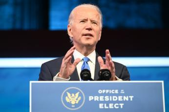 President-elect Joe Biden unveiled his plan to combat covid-19 and boost the nation's economy Thursday at The Queen Theater in Wilmington, Del. (ROBERTO SCHMIDT/AFP/Getty Images/TNS)