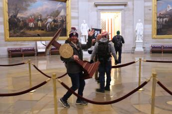 Adam Johnson, 36, of Parrish, faces felony charges after he was seen carrying House Speaker House Nancy Pelosi's lectern through the U.S. Capitol on Jan. 6. (WIN McNAMEE/Getty Images/TNS)
