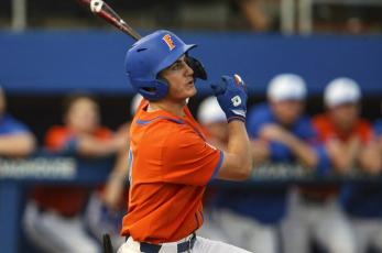 Florida outfielder Jud Fabian bats during a against Florida A&M last season in Gainesville. The Gators are in a familiar place as the consensus No. 1 team in the preseason. Fabian might be the best position player in the country. (AP FILE PHOTO))
