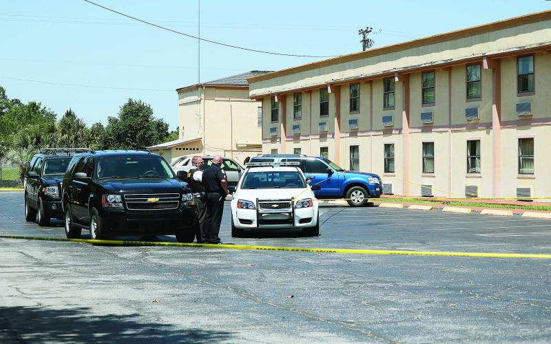 Officers at the scene of a homicide at the Ramada Limited motel on U.S. 90 in 2016. (FILE)