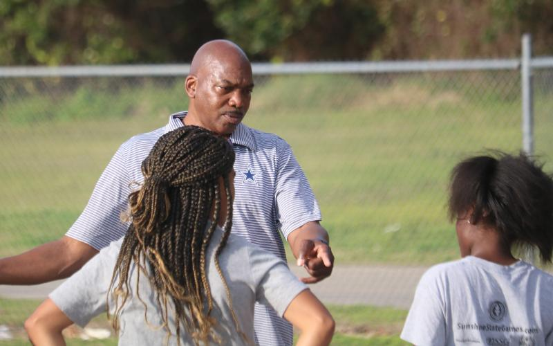Columbia coach Lawrence Davis talks to his athletes during Wednesday's practice. (JORDAN KROEGER/Lake City Reporter)