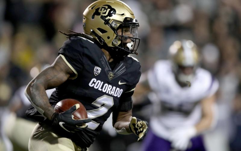 Laviska Shenault Jr. of the Colorado Buffaloes carries the ball against the Washington Huskies in the first quarter at Folsom Field on Nov. 23, 2019 in Boulder, Colorado. (MATTHEW STOCKMAN/Getty Images/TNS)