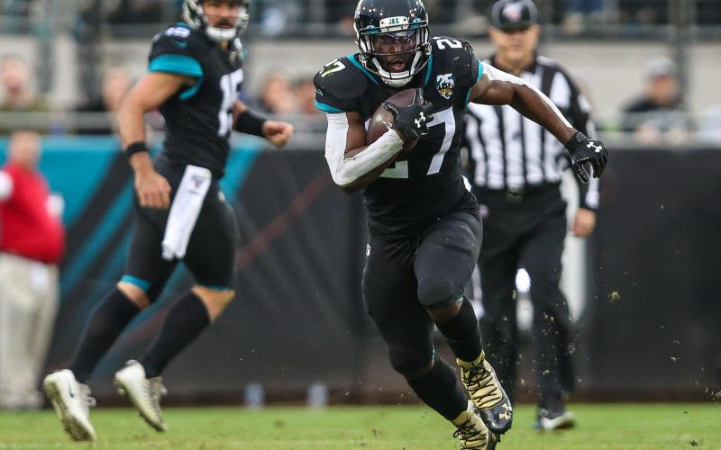 Jacksonville Jaguars running back Leonard Fournette (27) runs for a first down during the first half of an NFL football game against the Los Angeles Chargers at TIAA Bank Field, Sunday, Dec. 8, 2019 in Jacksonville. (TRIBUNE NEWS SERVICE)