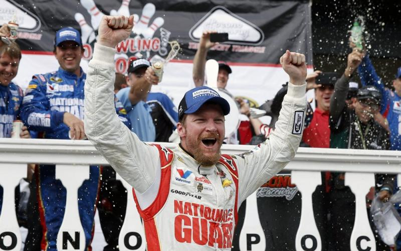 Dale Earnhardt Jr. celebrates in Victory Lane after winning a NASCAR Sprint Cup Series auto race at Pocono Raceway on Aug. 3, 2014, in Long Pond, Pa. (AP FILE PHOTO)
