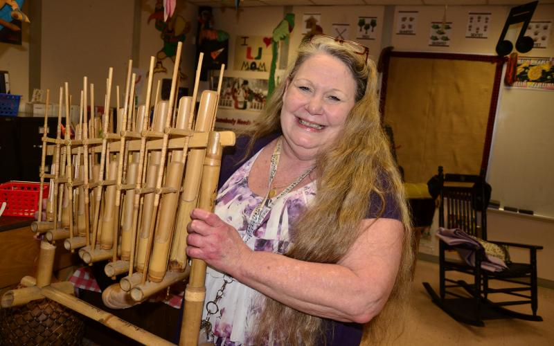 Eastside Elementary music teacher Teresa Cameron holds an angklung, an instrument originating in India. Cameron brought a large collection of world instruments with her when she joined Eastside 13 years ago. (CARL MCKINNEY/Lake City Reporter)