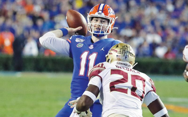 Florida quarterback Kyle Trask (11) throws a pass over Florida State linebacker Kalen DeLoach (20) during the first half of last year's game in Gainesville. (AP FILE PHOTO))