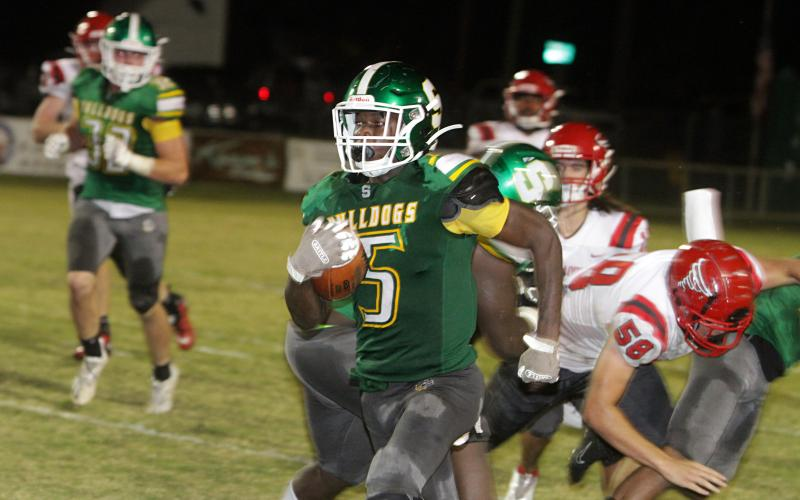 Suwannee defensive back Terrell Atkinson races down the sideline on an interception return for a touchdown on the final play of the first half Friday night against Bradford at Langford Stadium. (PAUL BUCHANAN/Special to the Reporter)