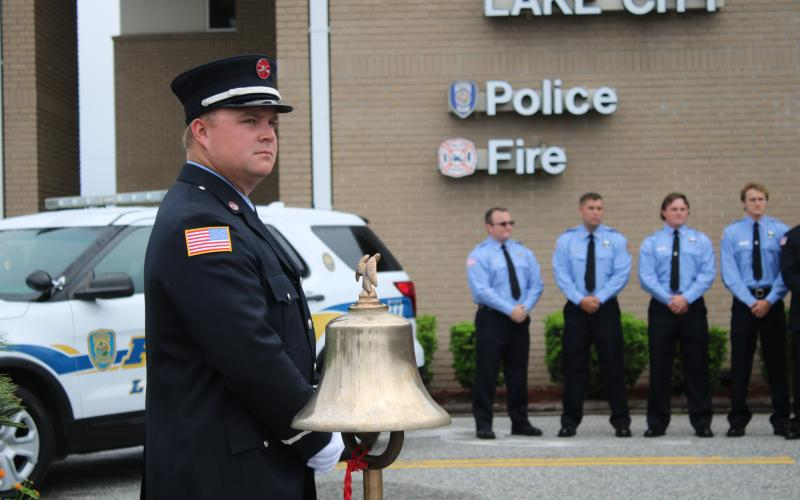 Daniel Dorn, a Lake City Fire Department driver/engineer, stands near a bell that was rung in honor of 9/11 terrorist attack victims Friday morning. (TONY BRITT/Lake City Reporter)