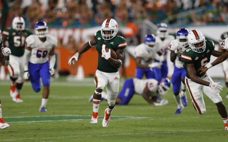 Former Miami running back Lorenzo Lingard runs in for a touchdown against Savannah State on Sept. 8, 2018, in Miami Gardens. No. 5 Florida will rely on a number of newcomers, including Lingard, as it tries to dethrone rival Georgia in the Southeastern Conference's East Division. Some of them are freshmen, others are transfers. (AP FILE PHOTO)