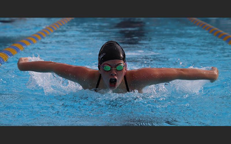 Columbia swimmer Kaydence Clark competes in the 100-yard butterfly during Wednesday's tri-meet against Saint Francis Catholic and Oak Hall. (SHELBY CONKLIN/Special to the Reporter)