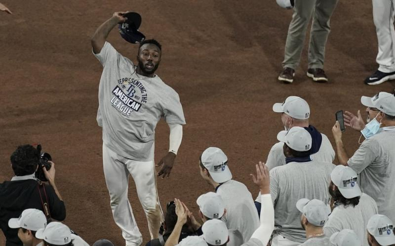 Tampa Bay Rays left fielder Randy Arozarena celebrates his MVP award following their victory against the Houston Astros in Game 7 of the American League Championship Series on Saturday in San Diego. The Rays defeated the Astros 4-2 to win the series 4-3 games. (JAE C. HONG/Associated Press)