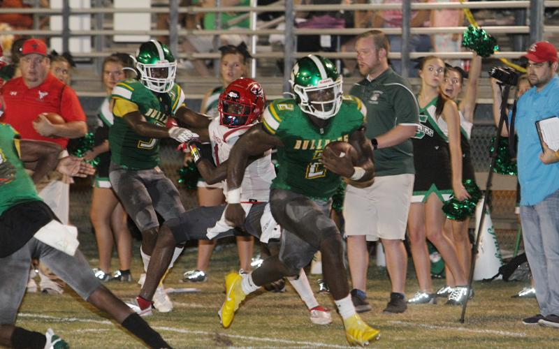 Suwannee quarterback Jaquez Moore bolts down the sideline to score a touchdown against Bradford last week. (PAUL BUCHANAN/Special to the Reporter)