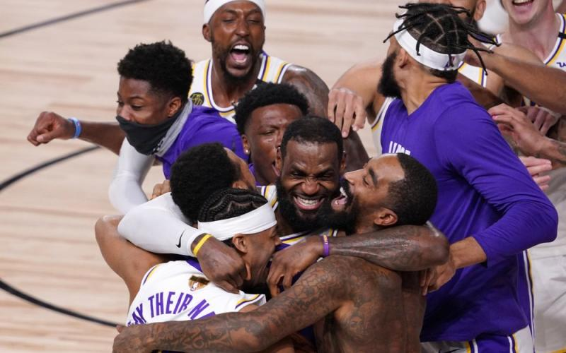 Los Angeles Lakers' LeBron James (23) celebrates with his teammates after the Lakers defeated the Miami Heat 106-93 in Game 6 of the NBA Finals on Sunday in Lake Buena Vista. (MARK J. TERRILL/Associated Press)