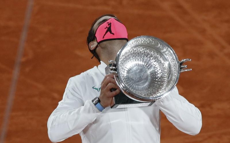 Rafael Nadal holds the trophy as he celebrates winning the final match of the French Open against Novak Djokovic in three sets, 6-0, 6-2, 7-5, at the Roland Garros stadium on Sunday in Paris, France. (ALESSANDRA TARATINO/Associated Press)