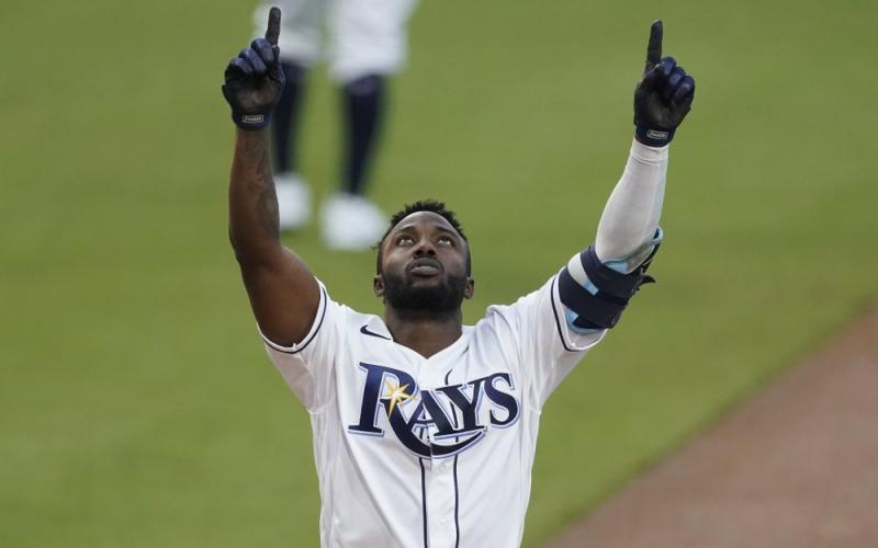 Tampa Bay Rays Randy Arozarena celebrates after hitting a two run home run against the Houston Astros during the first inning in Game 7 of the American League Championship Series on Saturday in San Diego. (ASHLEY LANDIS/Associated Press)
